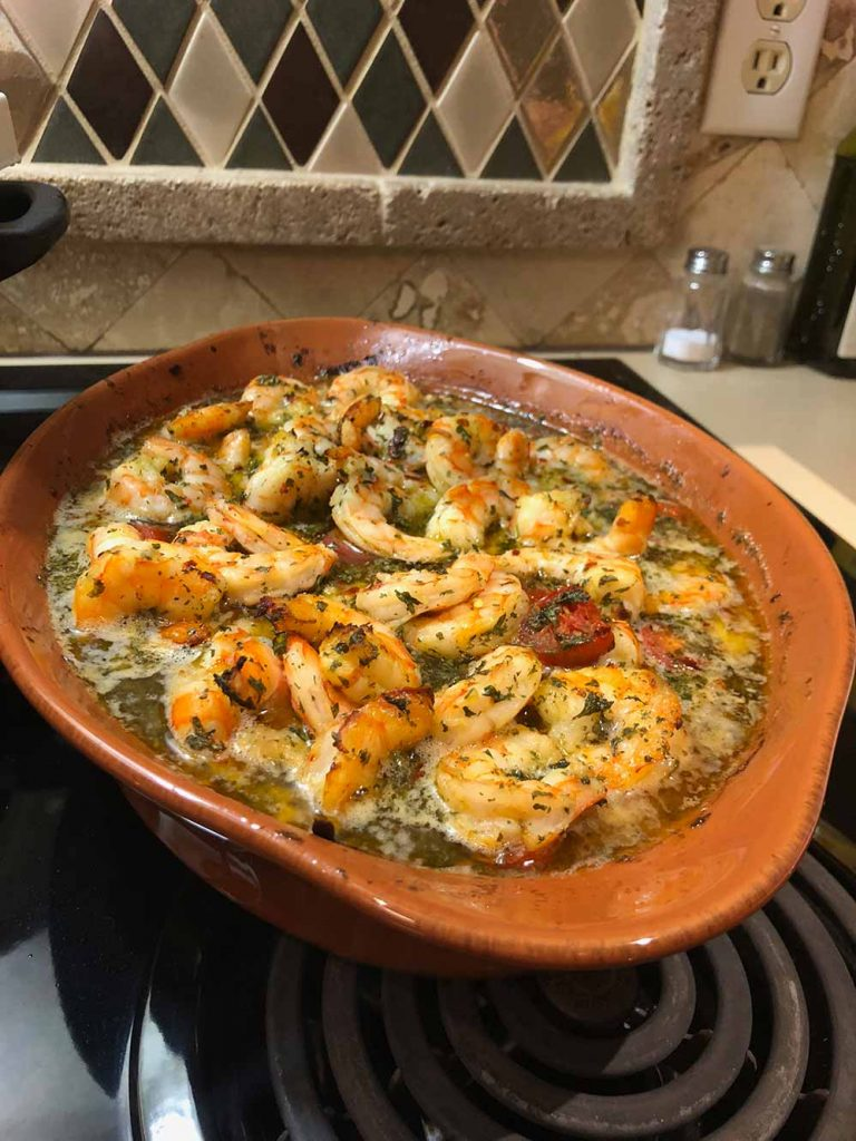 freshly baked spicy shrimp in olive oil and garlic